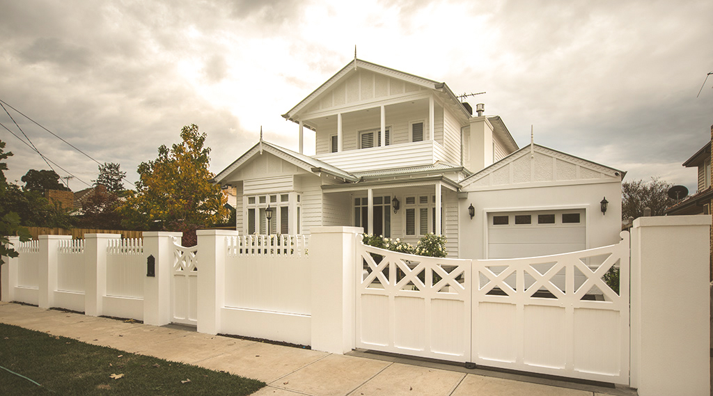 Picket fence with wooden gates